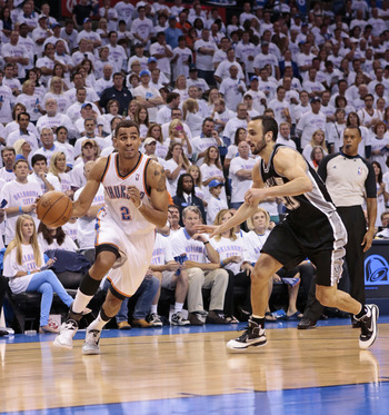 OKLAHOMA CITY, OK - JUNE 06:  Thabo Sefolosha #2 of the Oklahoma City Thunder drives on Manu Ginobili #20 of the San Antonio Spurs in Game Six of the Western Conference Finals in the 2012 NBA Playoffs on June 6, 2012 at the Chesapeake Energy Arena in Okla