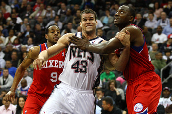 NEWARK, NJ - APRIL 23:  Kris Humphries #43 (C) of the New Jersey Nets fights for rebound position against Andre Iguodala #9 and Elton Brand (R) #42 of the Philadelphia 76ers at Prudential Center on April 23, 2012 in Newark, New Jersey. Tonight's game is t
