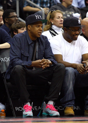 NEWARK, NJ - APRIL 23:  Hip-hop artist and part owner of the New Jersey Nets Jay-Z sits courtside as the Nets host the Philadelphia 76ers at Prudential Center on April 23, 2012 in Newark, New Jersey. Tonight's game is the last home game the Nets will play