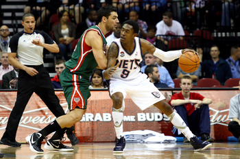 NEWARK, NJ - MARCH 12:  MarShon Brooks #9 of the New Jersey Nets moves the ball in the post against Carlos Delfino #10 of the Milwaukee Bucks at Prudential Center on March 12, 2012 in Newark, New Jersey.  NOTE TO USER: User expressly acknowledges and agre