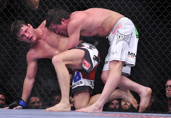 Jan 28, 2012; Chicago, IL, USA;  UFC fighter Chael Sonnen (top) fights against Michael Bisping during UFC on Fox 2 at the United Center. Sonnen defeats Bisping.  Mandatory Credit: Mike Dinovo-US PRESSWIRE