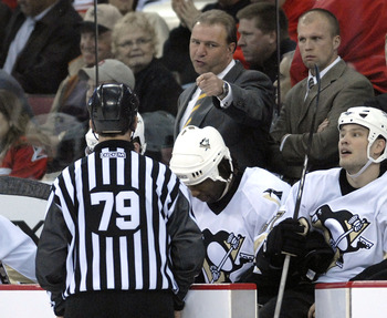 Michel Therrien behind the Pittsburgh Penguins bench.