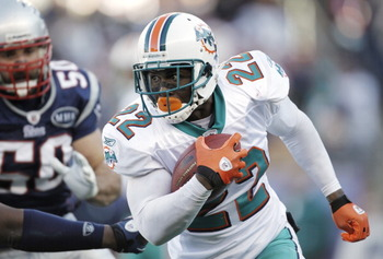 Reggie Bush ran for a career-high 1,086 yards with the Dolphins last season