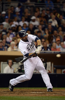 SAN DIEGO, CA - JULY 19:  Carlos Quentin #18 of the San Diego Padres swings at ball against the Houston Astros during theirMLB game on July 19, 2012 in San Diego, California. (Photo by Donald Miralle/Getty Images)