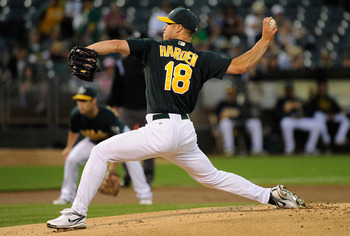 OAKLAND, CA - SEPTEMBER 20: Rich Harden #18 of the Oakland Athletics pitches against the Texas Rangers during an MLB baseball game at O.co Coliseum on September 20, 2011 in Oakland, California.  (Photo by Thearon W. Henderson/Getty Images)