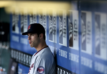 KANSAS CITY, MO - JUNE 4:  Joe Mauer #7 of the Minnesota Twins watches from the dugout during a game against the Kansas City Royals in the first inning at Kauffman Stadium June 4, 2012 in Kansas City, Missouri. (Photo by Ed Zurga/Getty Images)
