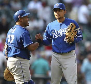 SEATTLE - SEPTEMBER 11:  Closing pitcher Joakim Soria #48 of the Kansas City Royals is congratulated by catcher Brayan Pena #27 after defeating the Seattle Mariners 2-1 at Safeco Field on September 11, 2011 in Seattle, Washington. (Photo by Otto Greule Jr