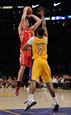LOS ANGELES, CA - APRIL 06: Goran Dragic #3 of the Houston Rockets scores on a jumper over Ramon Sessions #7 of the Los Angeles Lakers during a 112-107 Rockets win at Staples Center on April 6, 2012 in Los Angeles, California. NOTE TO USER: User express