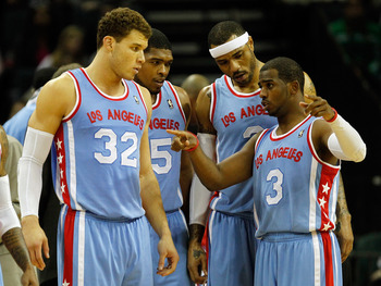 CHARLOTTE, NC - FEBRUARY 11:  Teammates Blake Griffin #32 of the Los Angeles Clippers Ryan Gomes #15 and Kenyon Martin #2 listen to Chris Paul #3 during a timeout against the Charlotte Bobcats at Time Warner Cable Arena on February 11, 2012 in Charlotte,