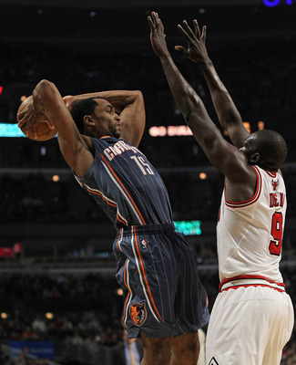 CHICAGO, IL - JANUARY 21:  Gerald Henderson #15 of the Charlotte Bobcats tries to pass over Loul Deng #9 of the Chicago Bulls at the United Center on January 21, 2012 in Chicago, Illinois. NOTE TO USER: User expressly acknowledges and agrees that, by down