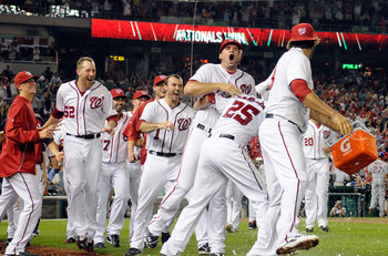 WASHINGTON, DC - JULY 17:  Ryan Zimmerman #11 of the Washington Nationals celebrates with teammates after scoring the game winning run in the tenth inning against the New York Mets at Nationals Park on July 17, 2012 in Washington, DC. Washington won the g