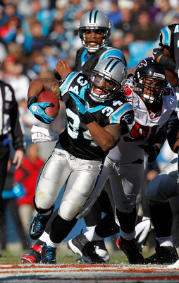 DeAngelo Williams (34) runs away from the Falcons' Corey Peters (91).