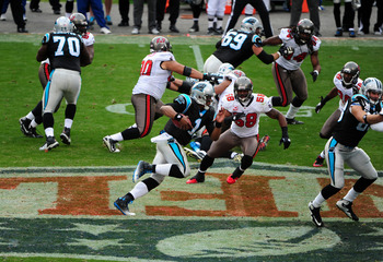 Cam Newton (1) takes off on a 49-yard touchdown run against the Tampa Bay Buccaneers on Christmas Eve 2011.