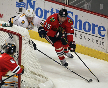 CHICAGO, IL - OCTOBER 31: Andrew Brunette #15 of the Chicago Blackhawks moves behind the net under pressure from Blake Geoffrion #5 of the Nashville Predators at the United Center on October 31, 2011 in Chicago, Illinois. The Blackhawks defeated the Preda