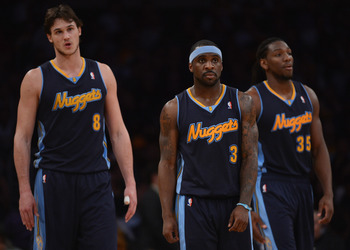 LOS ANGELES, CA - MAY 01:  Ty Lawson #3, Danilo Gallinari #8 and Kenneth Faried #35 of the Denver Nuggets head back to the court trailing the Los Angeles Lakers who would go on to win 104-100 to take a 2-0 series lead during Game Two of the Western Confer