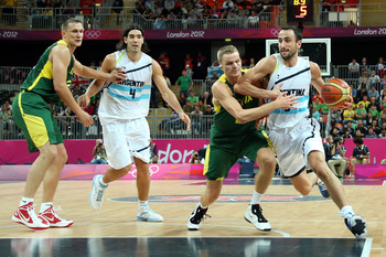 LONDON, ENGLAND - JULY 29:  Manu Ginobili #5 of Argentina dribbles the ball against Lithuania during their Men's Basketball Game on Day 2 of the London 2012 Olympic Games at the Basketball Arena on July 29, 2012 in London, England.  (Photo by Christian Pe