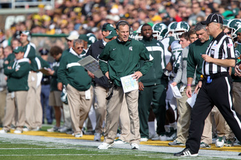 The men roaming the Michigan State sidelines have coached together for quite a while.