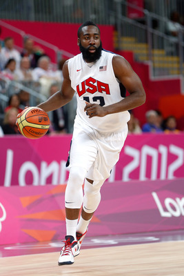 LONDON, ENGLAND - JULY 29:  James Harden #12 of United States moves the ball against France in the Men's Basketball Game on Day 2 of the London 2012 Olympic Games at the Basketball Arena on July 29, 2012 in London, England.  (Photo by Jamie Squire/Getty I