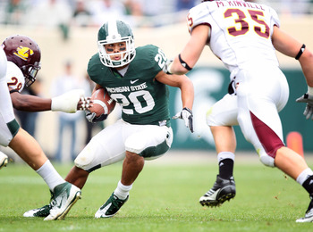 September 24, 2011; East Lansing, MI, USA; Michigan State Spartans running back Nick Hill (20) makes a cut against Central Michigan Chippewas linebacker Mike Kinville (35) and  defensive back Jarret Chapman (29) during the 2nd half at Spartan Stadium. Mic