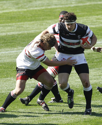 DURBAN, SOUTH AFRICA - AUGUST 7:  Marcel Coetzee of the Sharks is tackled during the ABSA under 19 match between the Sharks and Lions at Absa Park Stadium on August 7, 2010 in Durban, South Africa. (Photo by Anesh Debiky/Gallo Images/Getty Images)