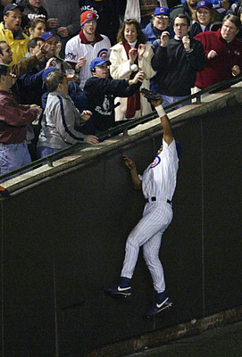 Cubs fan Steve Bartman prevents Moises Alou from making potential game-saving catch.