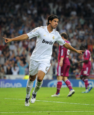 MADRID, SPAIN - OCTOBER 18:  Sami Khedira of Real Madrid celebrates scoring his sides second goal during the UEFA Champions League group D match between Real Madrid and Olympique Lyonnais at the Estadio Santiago Bernabeu on October 18, 2011 in Madrid, Spa