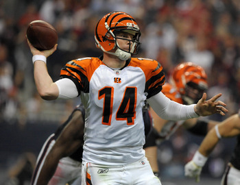 Jan 7, 2012; Houston, TX, USA; Cincinnati Bengals quarterback Andy Dalton (14) throws a pass during the AFC Wild Card Playoff game against the Houston Texans at Reliant Stadium. The Texans defeated the Bengals 31-10. Mandatory Credit: Kirby Lee/Image of S