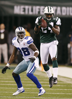 Sep 11, 2011; East Rutherford, NJ, USA; New York Jets defensive back Darrelle Revis (24) intercepts a pass intended for Dallas Cowboys wide receiver Dez Bryant (88) in the fourth quarter at MetLife Stadium. Mandatory Credit: William Perlman/THE STAR-LEDGE