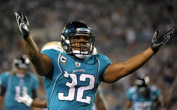 Dec 5, 2011; Jacksonville, FL, USA; Jacksonville Jaguars running back Maurice Jones-Drew (32) reacts after scoring on a 9-yard touchdown pass in the second quarter against the San Diego Chargers at EverBank Field. Mandatory Credit: Kirby Lee/Image of Spor