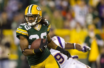 Nov 14, 2011; Green Bay, WI, USA; Green Bay Packers cornerback Tramon Williams (38) carries the football during the game against the Minnesota Vikings at Lambeau Field.  The Packers defeated the Vikings 45-7.  Mandatory Credit: Jeff Hanisch-US PRESSWIRE