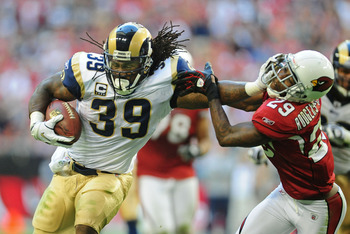 Dec. 5, 2010; Glendale, AZ, USA; St. Louis Rams running back (39) Steven Jackson stiff arms Arizona Cardinals cornerback (29) Dominique Rodgers-Cromartie in the first half at University of Phoenix Stadium. The Rams defeated the Cardinals 19-6. Mandatory C
