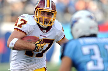 Nov 21, 2010; Nashville, TN, USA; Washington Redskins tight end Chris Cooley (47) runs with the ball against the Tennessee Titans during the first half at LP Field. The Redskins beat the Titans 19-16. Mandatory credit: Don McPeak-US PRESSWIRE