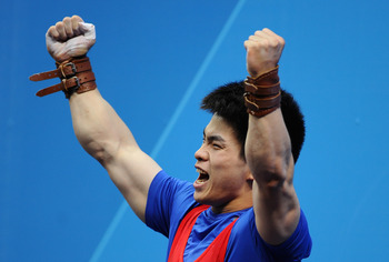 LONDON, ENGLAND - JULY 31:  Qingfeng Lin of China celebrates winning Gold during the Men's 69kg Weightlifting Final on Day 4 of the London 2012 Olympic Games at ExCeL on July 31, 2012 in London, England.  (Photo by Laurence Griffiths/Getty Images)