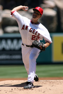 ANAHEIM, CA - JULY 29:  Zack Greinke #23 of the Los Angeles Angels of Anaheim pitches against the Tampa Bay Rays in the first inning at Angel Stadium of Anaheim on July 29, 2012 in Anaheim, California.  Greinke is making his Angels debut.  (Photo by Jeff