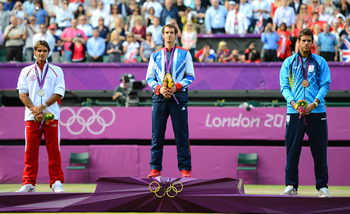 The presentation ceremony - L-R Federer, Murray and bronze medallist Juan Martin del Potro