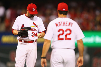Mike Matheny (22) has made too many unexpected trips to the mound to pull relievers like Marc Rzepczynski (34) late in games.