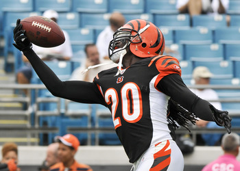Oct 9, 2011; Jacksonville, FL, USA; Cincinnati Bengals free safety Reggie Nelson (20) reaches for the ball during warm up drills before a game against the Jacksonville Jaguars at EverBank Field. Mandatory Credit: Fernando Medina-US PRESSWIRE