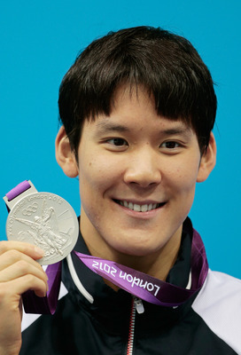LONDON, ENGLAND - JULY 30:  Silver medalist Tae-Hwan Park of Korea celebrates with his medal during the medal cermony for the Men's 200m Freestyle on Day 3 of the London 2012 Olympic Games at the Aquatics Centre on July 30, 2012 in London, England.  (Phot