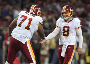 ST. LOUIS, MO - OCTOBER 2:   Trent Williams #71 and Rex Grossman #8 of the Washington Redskins celebrate in the fourth quarter of the game against the St. Louis Rams October 2, 2011 at the Edward Jones Dome in St. Louis, Missouri. The Redskins defeated th