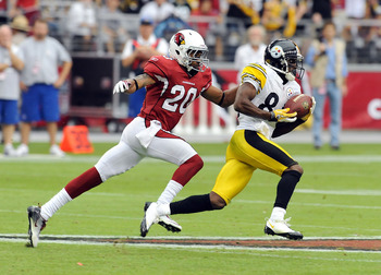 GLENDALE, AZ - OCTOBER 23:  Antonio Brown #84 of the Pittsburgh Steelers runs with the ball while being chased by A.J. Jefferson #20 of the Arizona Cardinals at University of Phoenix Stadium on October 23, 2011 in Glendale, Arizona.  (Photo by Norm Hall/G