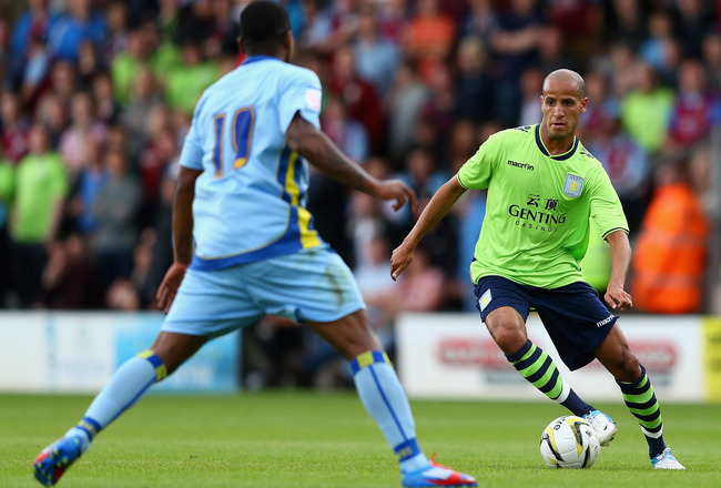 BURTON UPON TRENT, ENGLAND - JULY 14:  Karim El Ahmadi of Aston Villa in action during the pre season friendly match between Burton Albion and Aston Villa at the Pirelli Stadium on July 14, 2012 in Burton upon Trent, England.  (Photo by Clive Mason/Getty