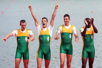 WINDSOR, ENGLAND - AUGUST 02:  Sizwe Ndlovu, John Smith, Matthew Brittain and James Thompson of South Africa celebrate before receiving their gold medals during the medal ceremony for the Lightweight Men's Four final on Day 6 of the London 2012 Olympic Ga