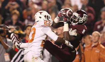 Nov 24, 2011; College Station, TX, USA; Texas Longhorns cornerback Carrington Byndom (23) breaks up a pass intended for Texas A&amp;M Aggies wide receiver Jeff Fuller (8) during the second quarter at Kyle Field. Texas won 27-25. Mandatory Credit: Thomas Campb