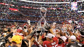 The Arkansas Razorbacks took the 2012 Cotton Bowl trophy