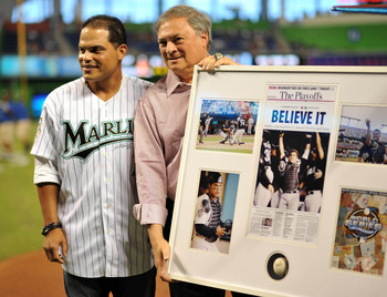 Marlins owner Jeffrey Loria (C)