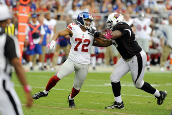 Levi Brown blocks Osi Umenyiora last season.