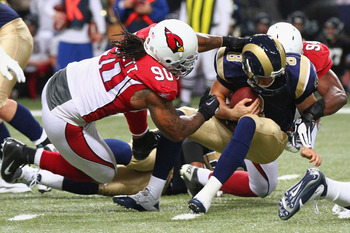 Dockett (left) takes down Sam Bradford for a sack.