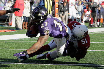Paris Lennon tackles the Ravens' Ray Rice.