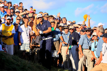Dustin Johson hits out of the infamous bunker at Whistling Straits.