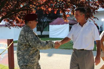 Allen greets Olaf Shibusawa, who is preparing for deployment. Redskins-WRCF